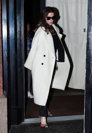 Kate Beckinsale showed off her impeccable winter style with this crisp white Dior coat while out and about in New York City.