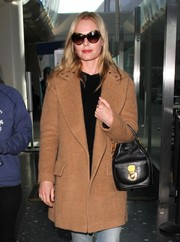 Kate Bosworth accessorized with a chic pair of cateye sunglasses during a flight to LAX.