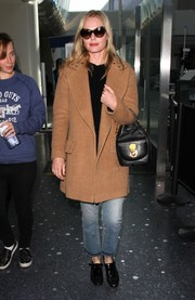 Kate Bosworth arrived on a flight at LAX looking cozy in a tan wool coat.