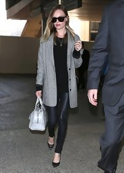 Kate Bosworth chose a pair of classic leather pants for her casual but cool look while arriving in LA.