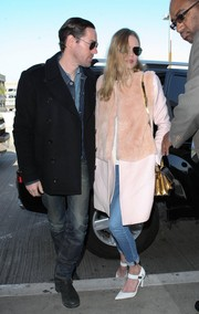 Kate Bosworth brought a dose of glamour to LAX with this pink rabbit fur-accented coat by Katie Ermilio.