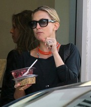 Kate Hudson styled her outfit with some layered beaded necklaces.