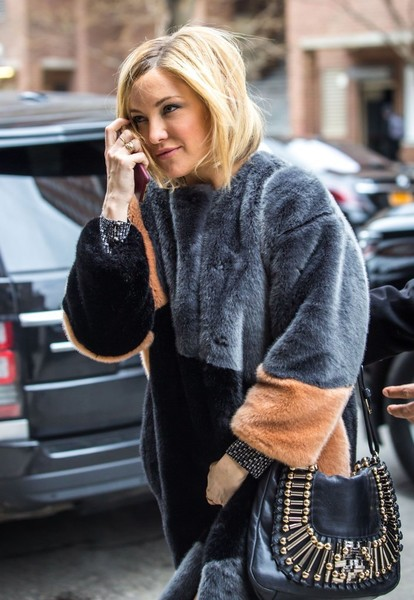 Kate Hudson stepped out in New York City carrying a stylish embellished messenger bag.