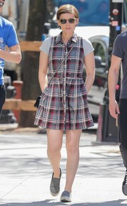 Kate Mara looked just like a teenager in this short plaid shirtdress while out strolling in New York City.
