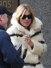 Kate Moss glammed it up in a pair of slightly cateye shades.