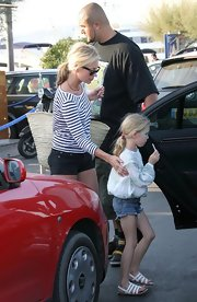 Kate keeps it casual with a messy low ponytail while she played mommy in St. Tropez.