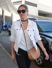 Kate Upton jetted out of LAX carrying a classic tan leather bag.