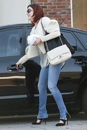 "A girl can never have too many bags, right? Kate is wearing a classic white chanel bag accompanied by the newly popular ""City bag"" by Stella McCartney."
