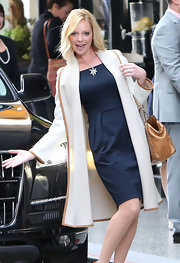 Katherine posed at the Beverly Hotel in this navy shift dress and draped coat.