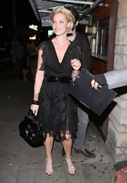 Katherine Heigl carried a ladylike black top handle tote to dinner with her husband.