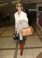 Katherine Heigl's tan leather knee-high boots were a warm finish for her fashionable airport style.