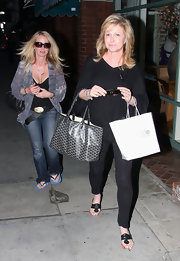 Kathy Hilton complemented her all-black outfit with a Goyard tote.