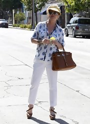 Kathy Hilton looked comfy in a print button-down shirt and slacks while out shopping.