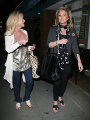 Kathy Hilton's black thong sandals looked super comfy for walking.