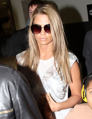 Katie Price flew into LAX in a pair of oversized round sunglasses with rosy lenses.