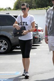 While out shopping in West hollywood Katy showed off her favorite bag of the moment. Her leather quilted bag is perfect and goes with everything including her casual gym outfit.