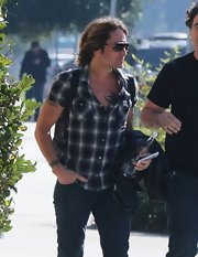 Keith Urban's country roots came out when the singer donned a loosely buttoned plaid shirt to head into the studio.