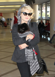 Kelly Osbourne looked retro chic in black framed cateye sunglasses.
