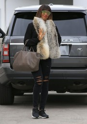 Kelly Rowland played with contrasts when she went shopping in Beverly Hills, pairing grungy slashed jeans with a luxurious fur stole.