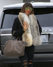 Kelly Rowland cut a glamorous figure wearing this fur scarf while shopping in Beverly Hills.