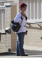 Sharon Osbourne carried a large quilted tote as she shopped with her daughter in Beverly Hills.