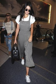 For a flight, Kendall Jenner channeled her inner little girl in these gray Forever 21 overalls.