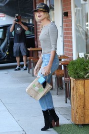 Hailey Baldwin teamed her cute top with ripped jeans by Mother.