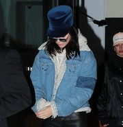 Kendall Jenner kept a low profile with a blue velvet military cap and a pair of shades while enjoying a night out.