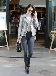 Kendall Jenner was tough-glam in a snake-effect leather jacket by Elizabeth and James teamed with skinny jeans while filming scenes for her reality show.