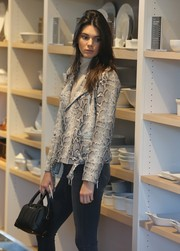Kendall Jenner accessorized with a cute Givenchy Lucrezia micro-satchel while filming scenes for her reality show.