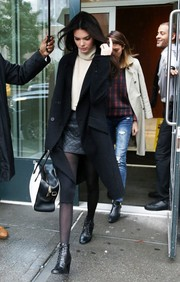 Kendall Jenner looked fall-ready in a black wool coat layered over a turtleneck and a leather mini while out in New York City.