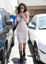 Black Alaia cutout boots provided a fierce finish to Kylie Jenner's look.