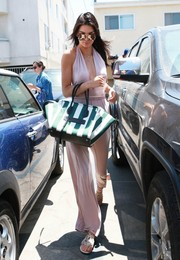 Kendall Jenner wowed in a deep-V pink halter jumpsuit by Krisa while out for lunch in West Hollywood.