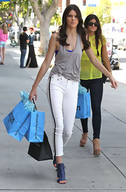 Kendall looked sporty and stylish in these white racer-stripe skinnies.