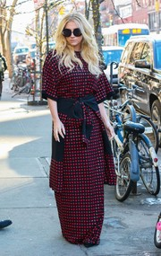 Kesha covered up in a red and black maxi dress by Adam Selman for a day out in New York City.