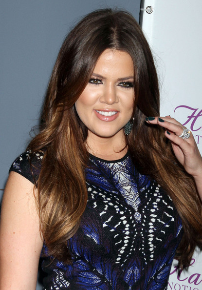 Khloe Kardashian walked the red carpet with fluttering lashes at the HPNOTIQ Harmonie launch party. This dramatic beauty look worked perfectly with her daring Alexander McQueen dress.
