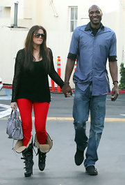 Lamar Odom looked low-key next to his wife in his chambray button-down and jeans combo.