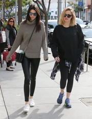 Kendall Jenner teamed a taupe 1—01 Babaton for Aritzia turtleneck with black leather leggings for a day of shopping.