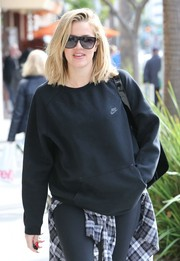 Khloe Kardashian opted for modern, angular shades when she stepped out for a day of shopping.