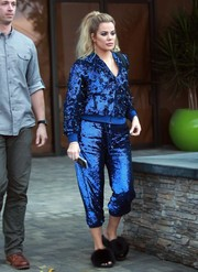 Khloe Kardashian was a sight to behold in a royal-blue sequin bomber jacket by Ashish while visiting a studio in Westlake.