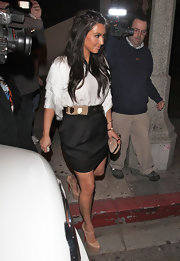 Kim Kardashian took on the town in nude platform mary jane pumps.