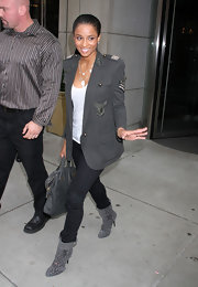Ciara rocks this military look hard!  Out in NYC with Kim K, this stylish songstress is decked out in military chic in this gray embellished blazer.
