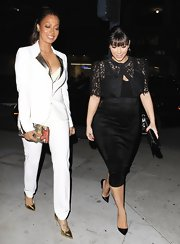 La La Anthony looked seriously stylish in a white pantsuit with silver lapels during a dinner out with Kim Kardashian.