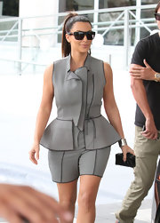 Kim Kardashian looked thoroughly modern in a textural peplum short suit.