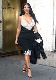 Kim Kardashian was on curve-flaunting mode once again in a black-and-white lace-panel dress by Celine while out and about in New York City.