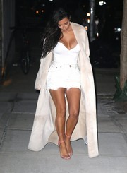 Kim Kardashian showcased her cleavage and tiny waist in this fitted white top while enjoying a night out in New York City.