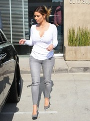 Kim Kardashian could definitely make a simple white henley shirt look oh-so-sexy.