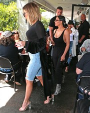 Khloe Kardashian stepped out for lunch wearing a black Love x Labels satin duster.
