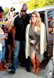 Kim Kardashian stopped by her store wearing a draped gray Donna Karan dress that hugged her voluptuous figure perfectly.