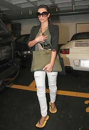 Kim Kardashian was spotted coming out of the nail salon toting her army green tote bag.